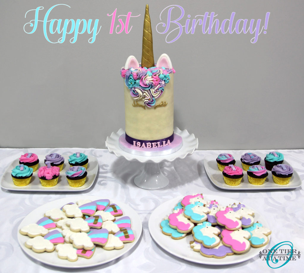 Unicorn themed dessert table with unicorn cake, unicorn cookies, and unicorn cupcakes